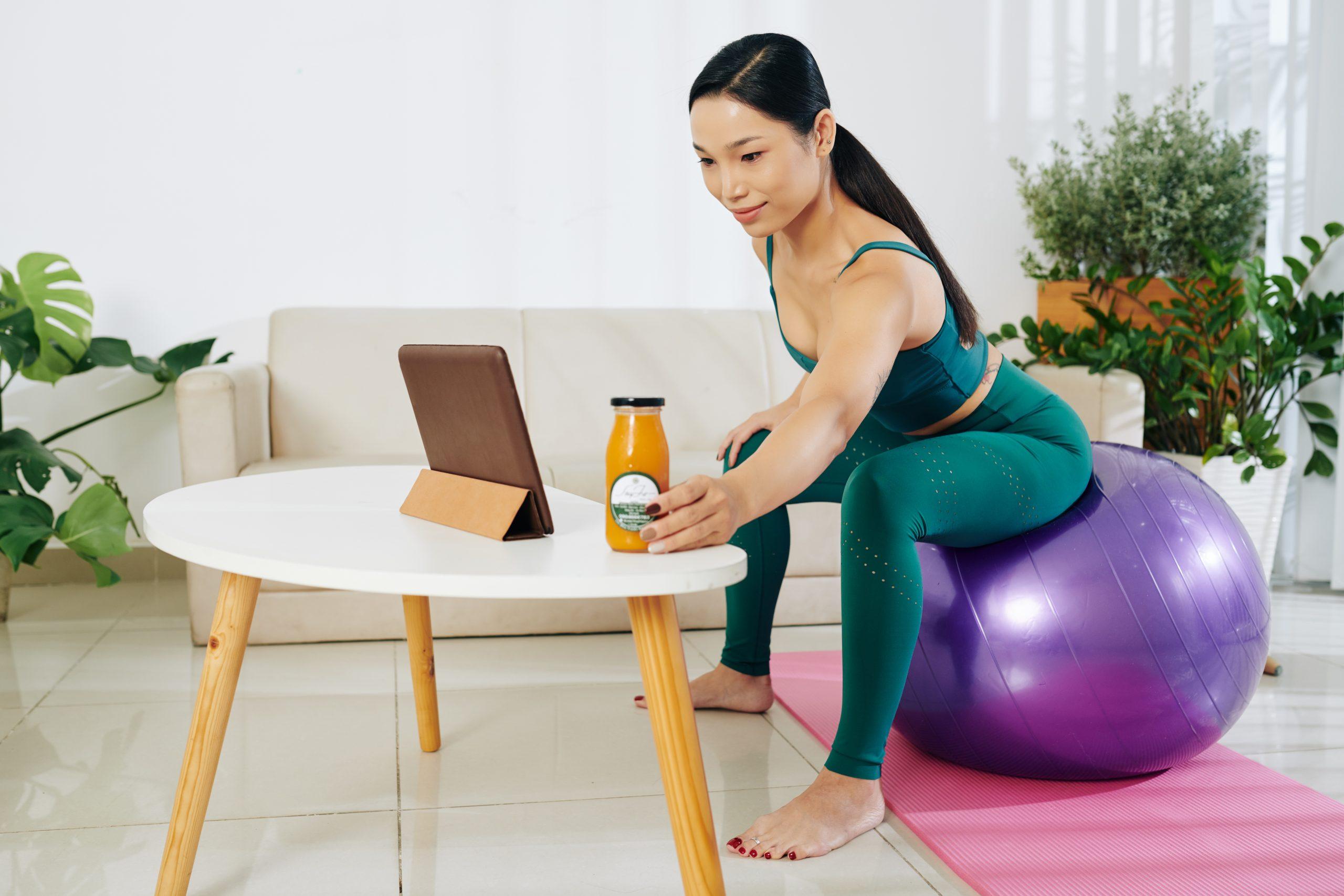 Sportswoman drinking juice